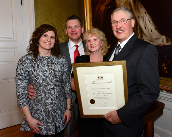 David and Christine Boyd of Prime Berth attend the post-award reception at Government House with family members.