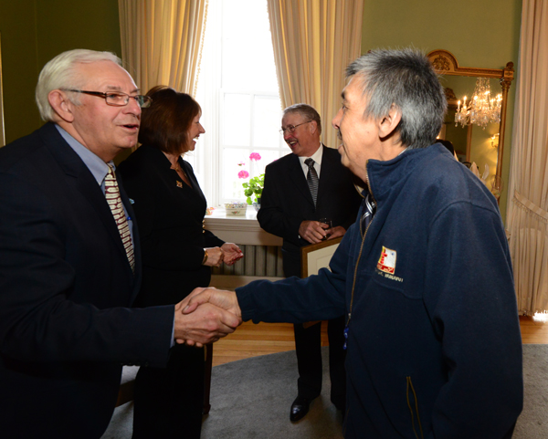 Mr. Levi Nochasak, heritage carpenter who worked on the Hebron Mission restoration, meets His Honour, The Honourable Frank F. Fagan at the post-award reception at Government House.