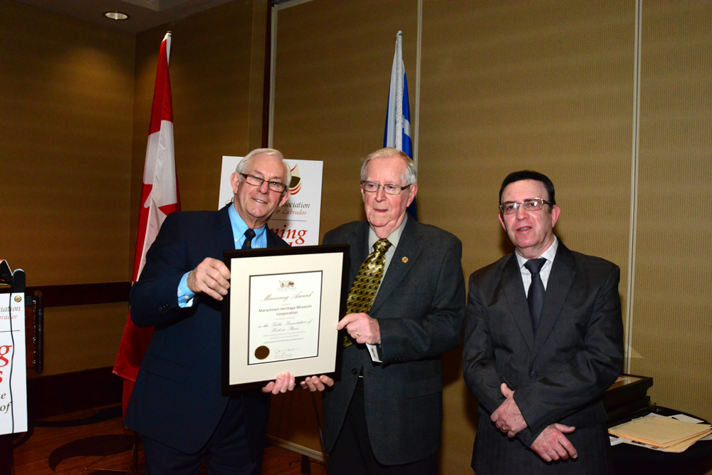His Honour presents the award to Marystown Heritage Museum Chair and Co-Chair, Albert Dober and Con Fitzpatrick