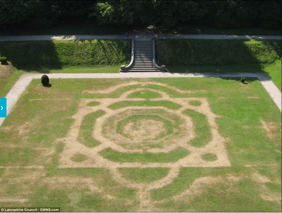 Figure 1 - Digital photograph of parchmarks revealing former formal garden below lawn, see online  Daily Mail  for more information.