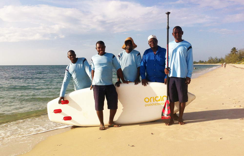 Guludo activities team with origin paddleboard.jpg