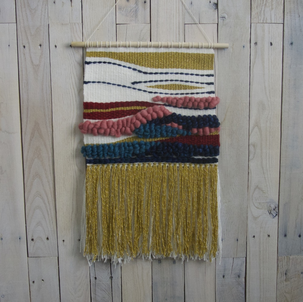 textured handwoven wall hanging.jpg