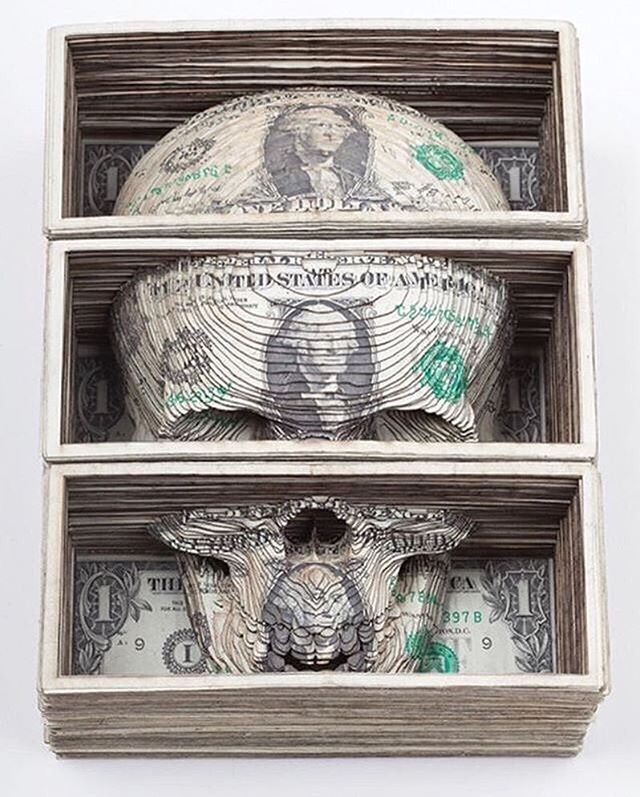 Carved Dollar bill skull sculpture by Scott Campbell @scampbell333