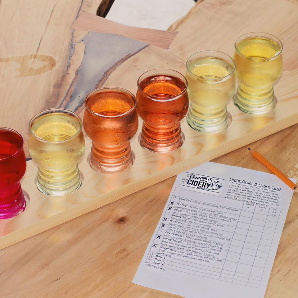 Picture of cidery flight with scorecard