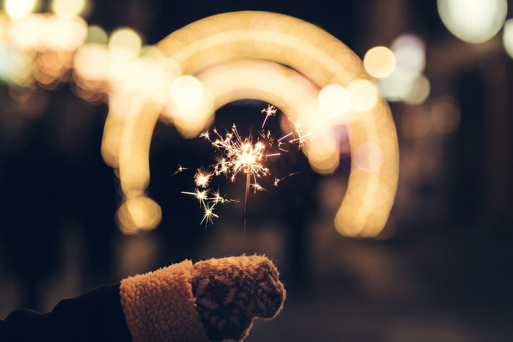 negative-space-celebration-hand-sparkler-fireworks-lights-night-freestocks.jpg
