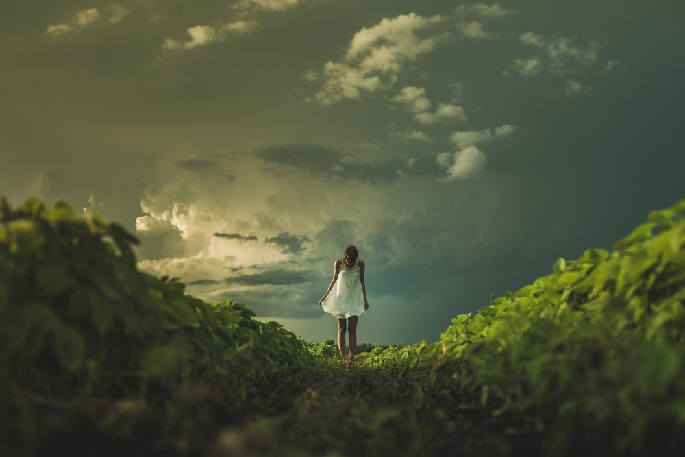 negative-space-woman-white-dress-field-clouds-matthew-henry.jpg