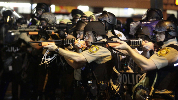 Police-officers-point-their-weapons-at-demonstrators-protesting-against-the-shooting-death-of-Michael-Brown-in-Ferguson-Missouri-August-18-2014.-REUTERS_Joshua-Lott1