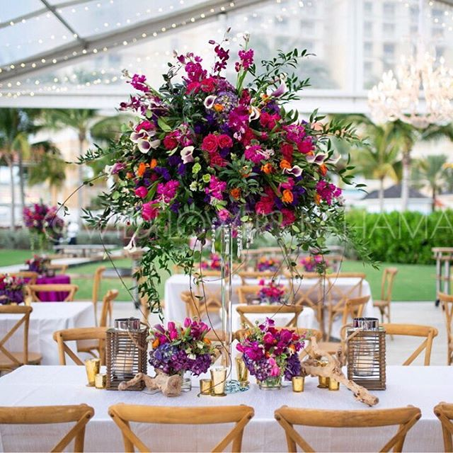 We are crazy about this beautiful color scheme! The vibrant colors came together beautifully! * * * * #corporateevents #wildflowers #dmc #vibrant #bahamas #bahamasevents #bahamar #flowers #eventplanning #eventdesign #tent #tentit