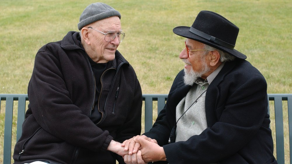 "Father Thomas Keating and Rabbi Zalman Schachter-Shalomi in Denver, Colorado, 2005, dialoguing on the ""Kiss of God."" Photo by Edis Jurcys, 2005."