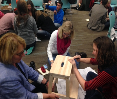 BVSD workshop participants patiently construct the IKEA stool.
