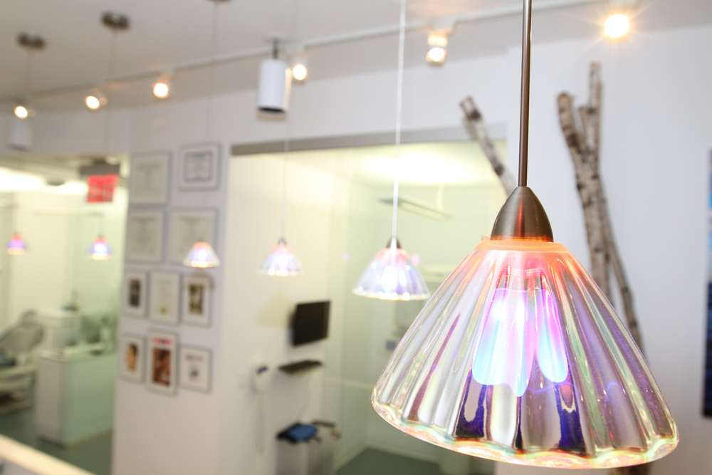 Our office used to be an art gallery. We salvaged many of the art gallery lights to maintain the feeling of a creative space.