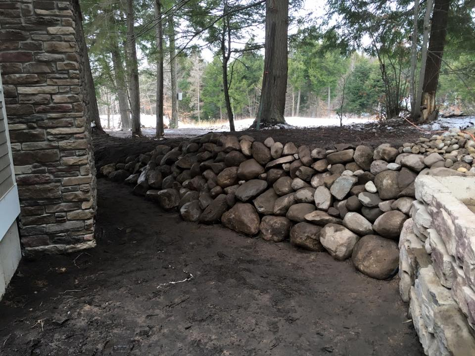 Natural rock wall for new home