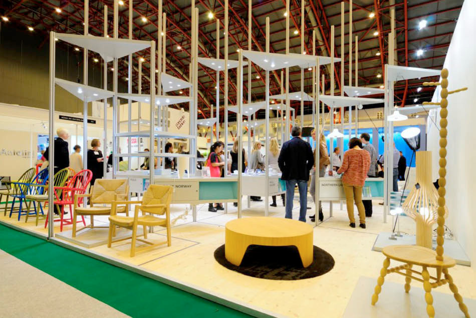 "100% Norway Fantastic Norway was recently awarded second place for best stand design at 100% Design in Earls Court / London, by Blueprint Magazine. The jury stated: ""Within the context of the exhibition's opening debate, surrounding ideas of the post-national nature of design, a country which has attempted to capture some essence and the characteristics of Norwegian design is an interesting exploration, and one which the Blueprint judges deemed worthy of special commendation"". Our design was not mainly a stand for 100% Norway, but first and foremost a flexible exhibition system that has the ability to adapt into different spaces: From small and narrow areas to larger halls and spaces. The stand design consists of a series of triangles and squares and it employs aluminium poles and a wooden puzzle like floor. Our aim was to not make a retrospective and romantic stand, but rather create system with modern materials. Our focus is that Norway should be promoted as a modern and hi-tech society. Throughout history our coastal culture has always had the ability to absorb new ideas, and has been adaptable during changing times. Therefore, Norwegians have in one way always been really modern. The design and production was led by Lars Goossens (Fantastic Norway), in close colaboration with Bjørnar Gudbrandsen (NSI)."