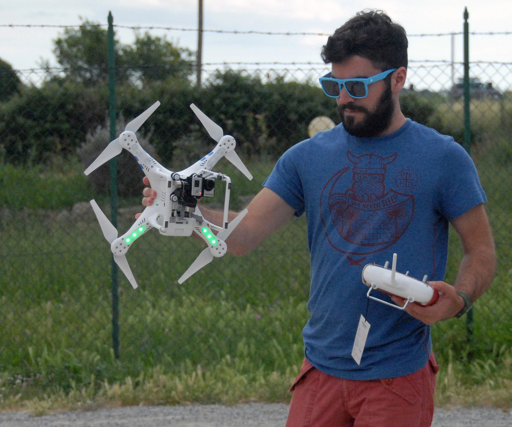 Matthew brennan prepares the quadcopter