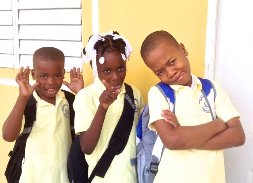 T12 students Christ Capable, Wichnida, Isaac posing for a funny photo before school.