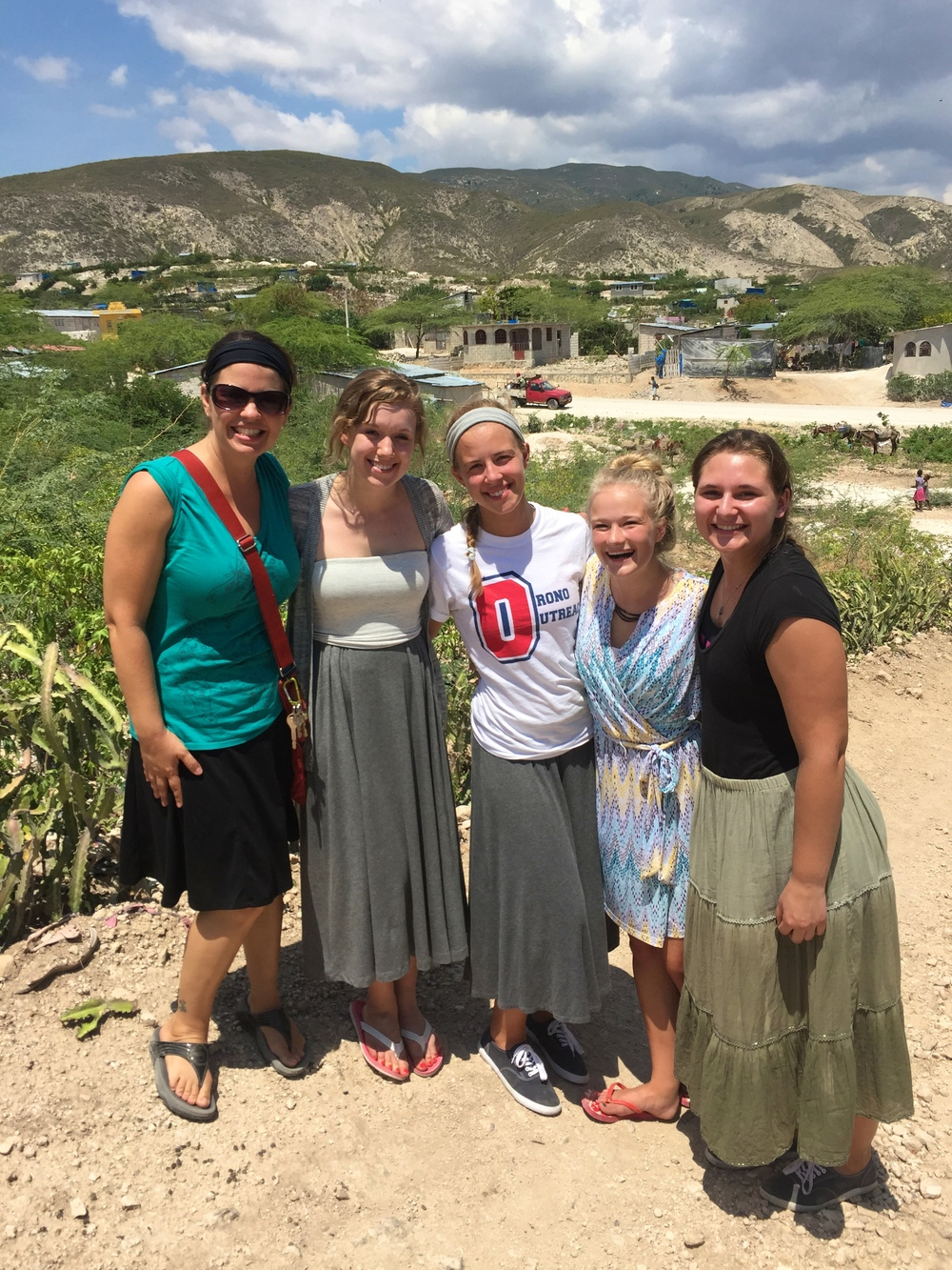 Some of the girls in Titanyen with our friend and fearless captain today Jennifer.