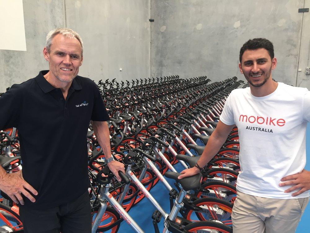 TAG Mobility GM Derek Mollison with Mobike Australia GM Mina Nada