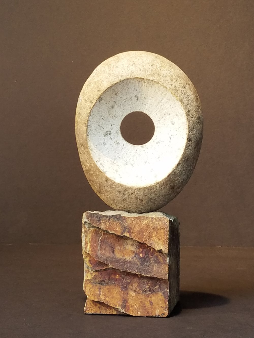"This is from a series of works using beach stones from Santa Cruz. This one was presented as an award from Film Independent to George Clooney in 2005. Medium: Granite on Wood Base Dimensions: 5"" x 8"" x 12"""