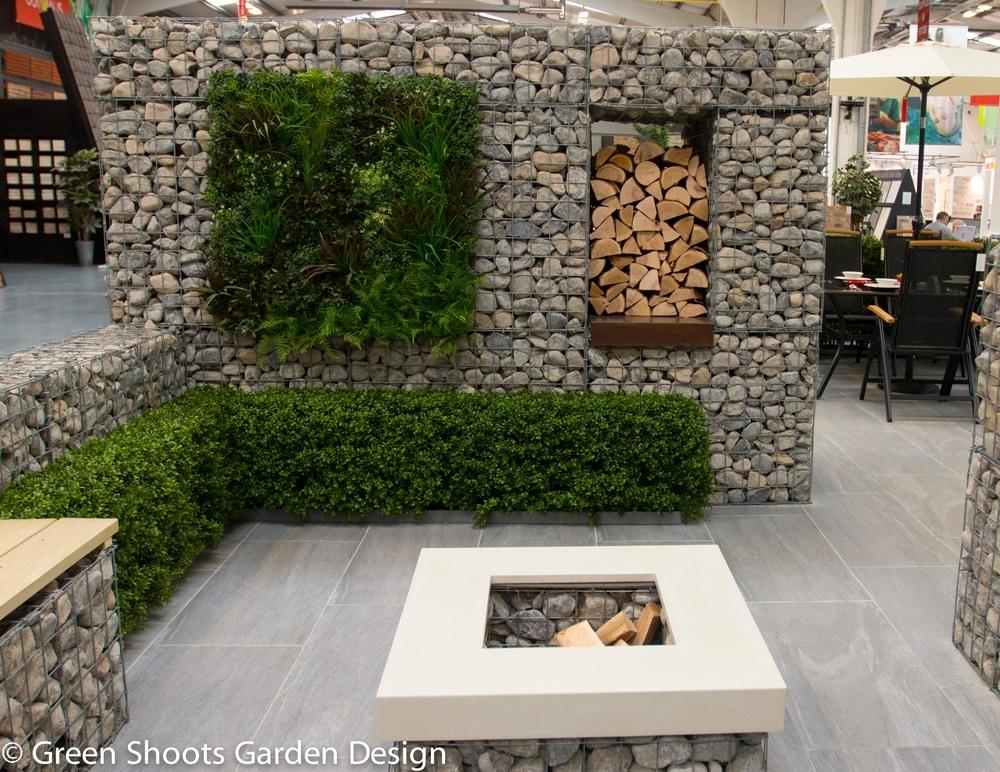Gabion walls,L shaped bench seating & bespoke concrete firepit