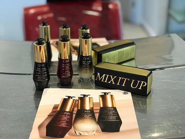 GIVE YOURSELF A BOOST!! 💁🏽‍♀️✨ Who's ready to mix it up with Oribe's new highly concentrated elixirs! Mix them into any Oribe product or use them on their own! - •Power Drops Hydration & Anti- Pollution Booster: provides an intense dose of deep hydration & defends against environmental pollution • Power Drops Color Preservation Booster: provides an intense dose of antioxidants & amino acids to shield hair from UV rays & enhance color retention •Power Drops Damage Repair Booster: provides an intense foes of essential nutrients to rebuild & restore dry, damaged, time-weakened hair