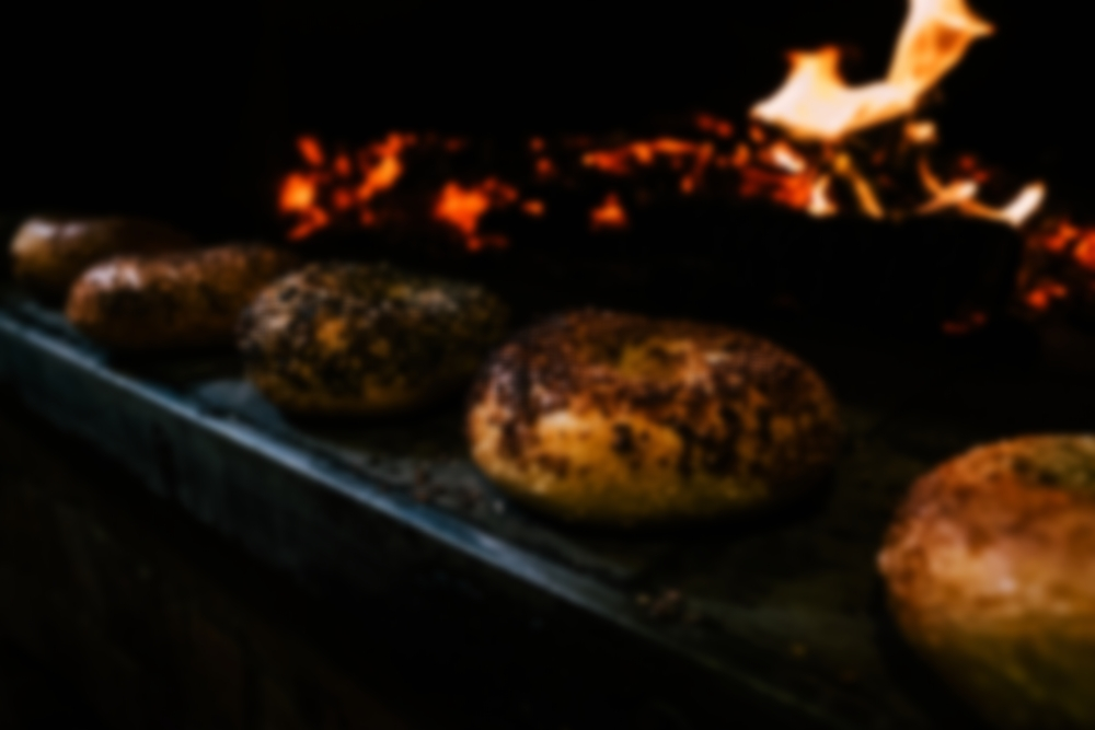 In the wee hours of the morning, our valiant bakers start the fire in our brick oven. -  It takes three hours to get the oven hot enough to bake a great bagel. When we're asked what makes our bagels so good, we show people the oven.