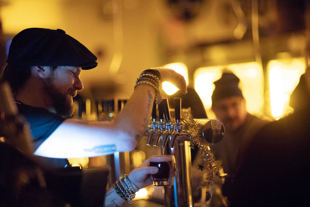pouring beer from taps