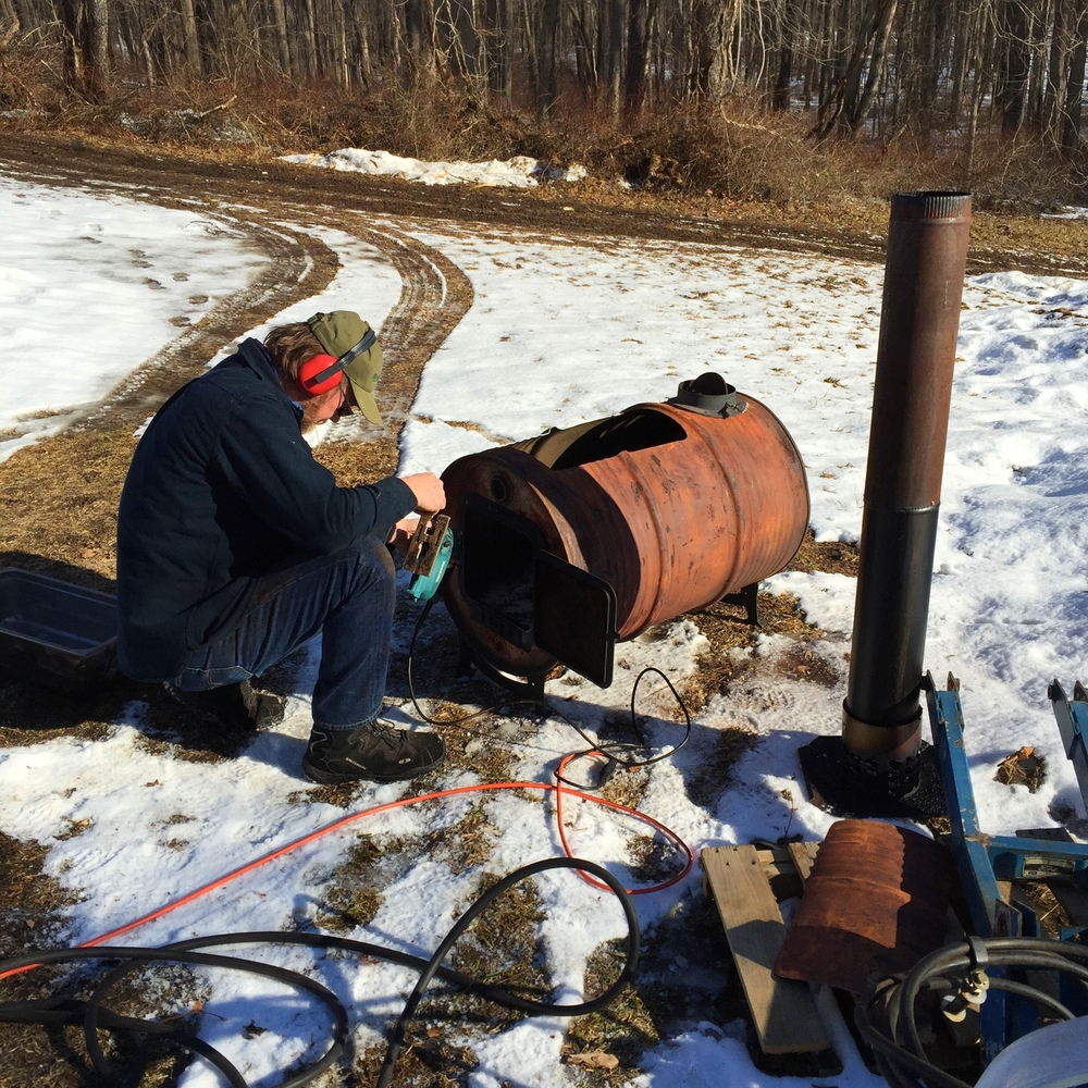 Peter working on the barrel stove