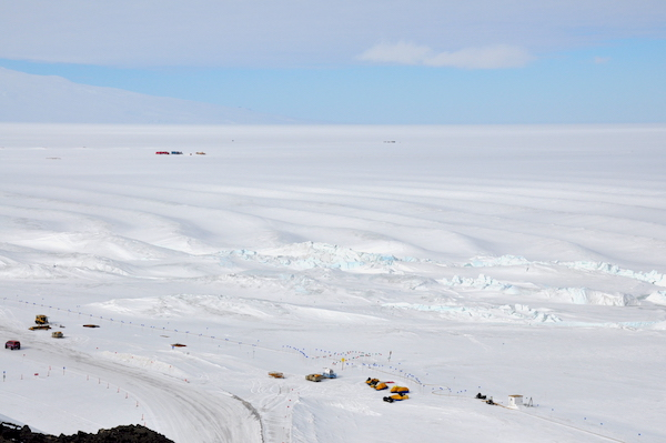 "The crumbly pressure ridges in the foreground with the ""Rollers"" in the background. If they weren't frozen I'd have my long board out in a minute! The Rollers are compression ridges in the McMurdo Ice Shelf where it anchors against the shore of Ross Island."