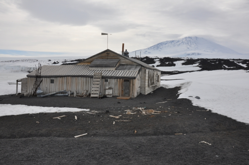 The Terra Nova Hut lovingly restored and preserved by New Zealand's Antarctic Heritage Trust. Mt Erebus looms behind.