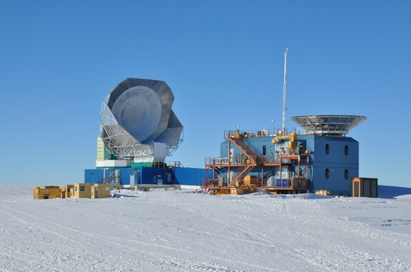 The South Pole Telescope primary mirror (left) and the shielded aperture of BICEP 3 (right). The outhouse is on the extreme right and is considerably lower tech!