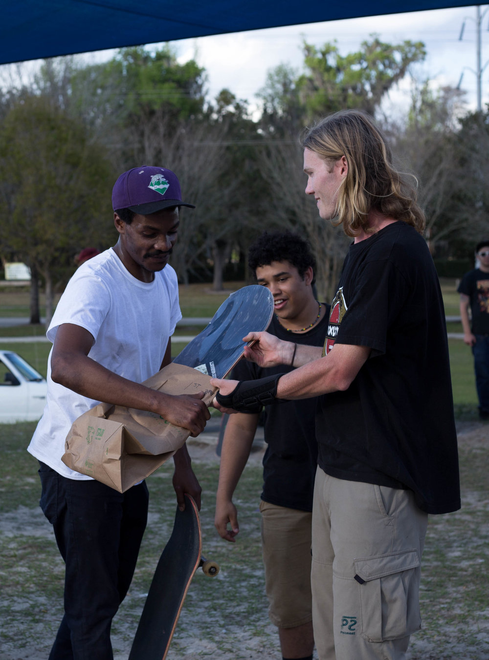 Dante DeBose get hooked up! Gator Skate Club member, Patrick Lynch, passes the product.