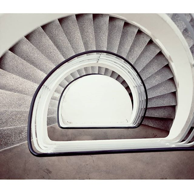 Euro Campers test shots 15/18  A test shoot for a photo series I'm exploring. I ventured into the Netherlands and Germany looking for permanent or semi-permanent motor-home travellers.  I came across this staircase crossing the Breezanddijk. The symmetrical spiral stairwell forced me to take the cliche number. An indulgent guilty pleasure.