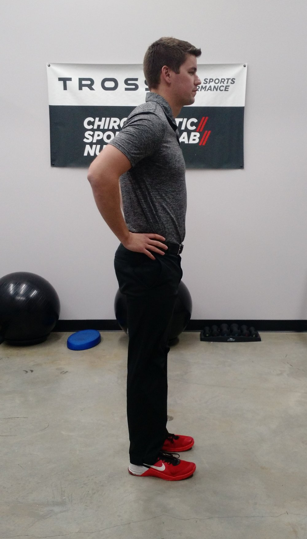 Start with the hands around your hips standing straight up.