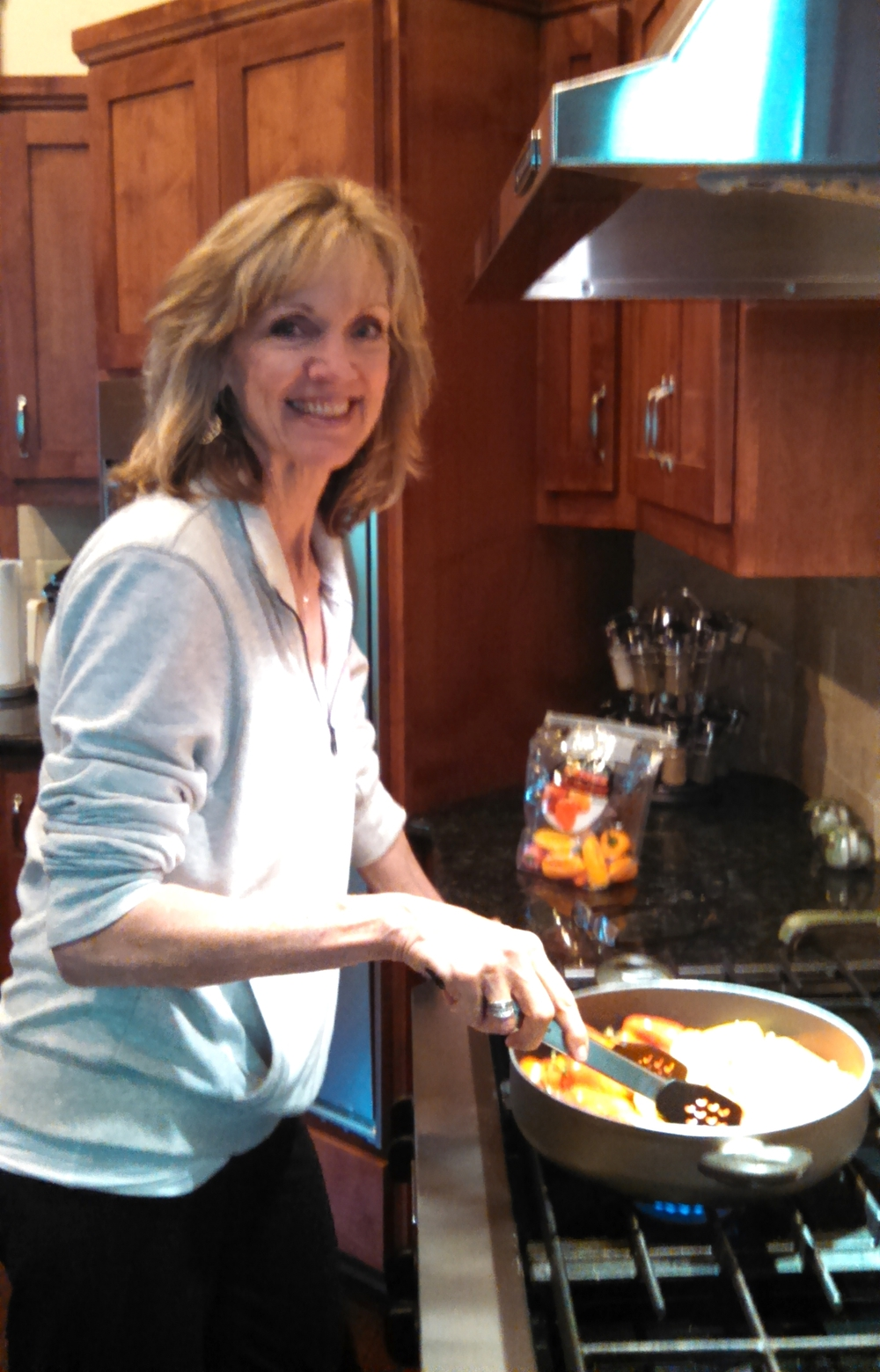Hostess Sharon Kinney preparing mini peppers