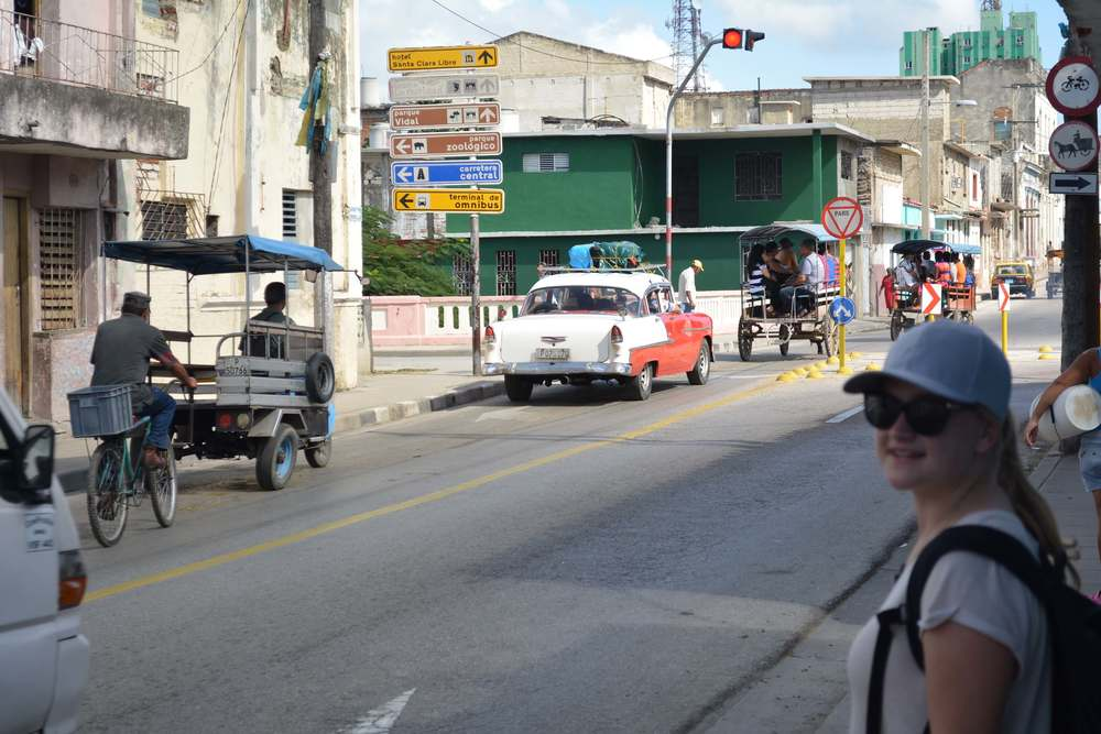 Mototaxis, 1950s cars, horse carriage buses, Russian trucks - a typical Cuban street scene in Santa Clara