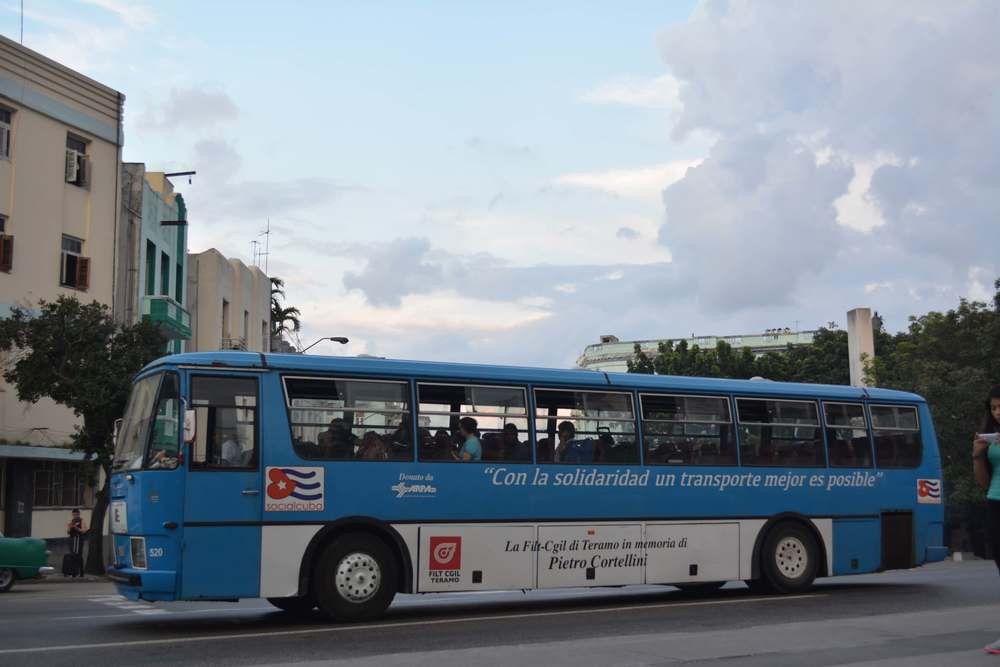 "Socialism lives on in Cuba - this new bus advertises ""With solidarity, better transport is possible"""