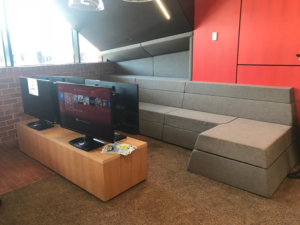 The library does not have dedicated spaces for young people, rather youth friendly features throughout including this playstation bay.