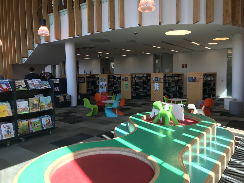The children's area is connected to an outdoor play space, and co-located with maternal and early childhood health rooms.