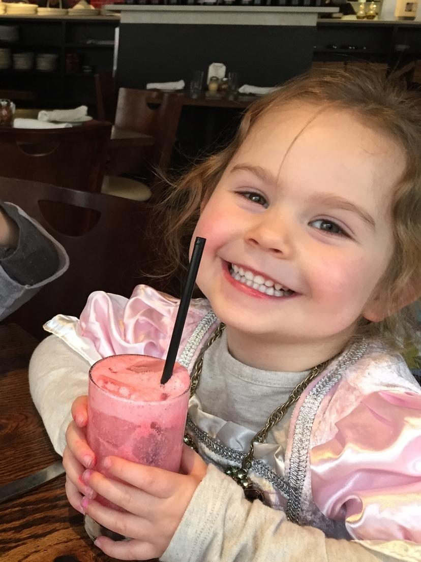 Enjoying a pink princess drink at a princess show. Because pink.