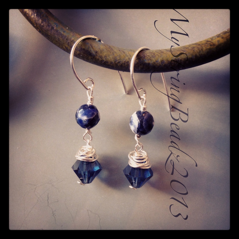 A pair of earrings made with sapphire coloured swarovski crystals.  An affordable alternative to the real deal!