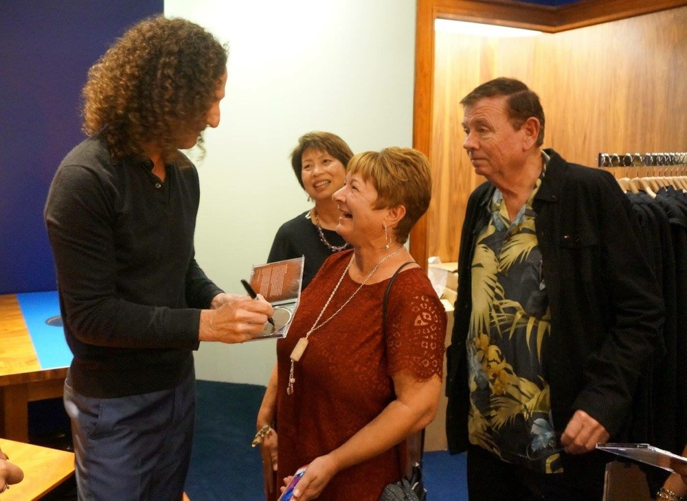 "Miss J wearing a ""Corked"" pendant while meeting Kenny G backstage in Maui!"