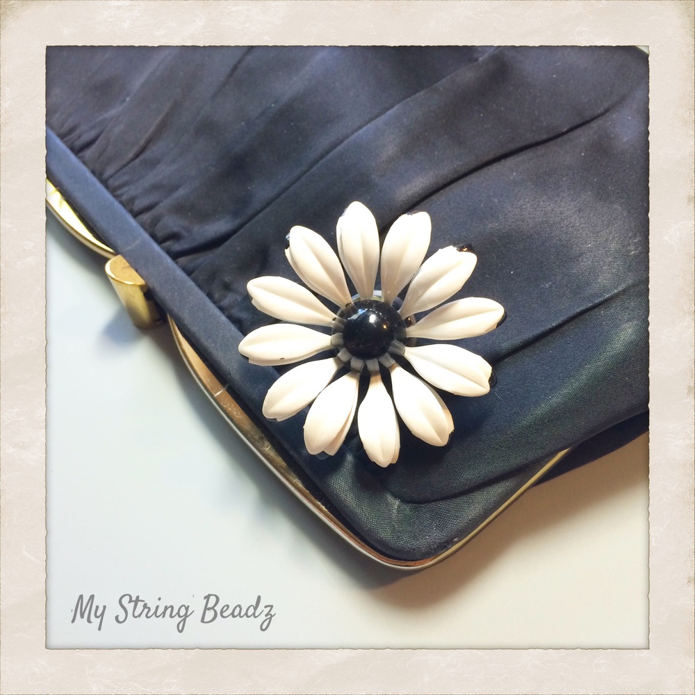 A large metal daisy brooch is now a striking fridge magnet!