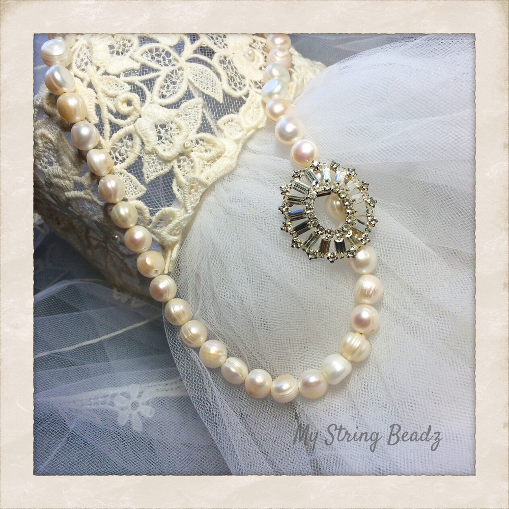 A stunning vintage brooch is paired with a new string of cultured pearls.  Wear together or just brooch or just pearls!