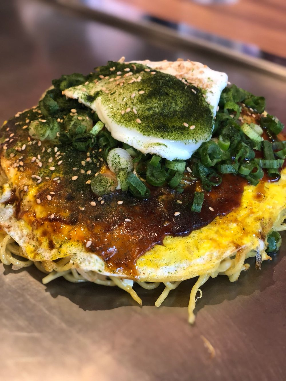 The B&C (basil and cheese) okonomiyaki with an egg from Chinchikurin.