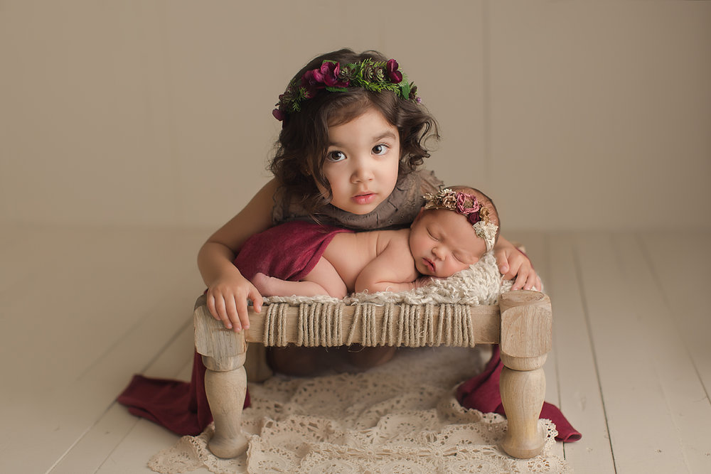 orange-county-newborn-photography-irvine-baby-girl-sibling-sister-red.jpg