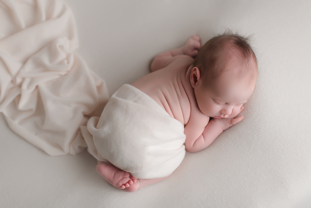 oc-newborn-photography-studio-simple-baby-white-blanket.png