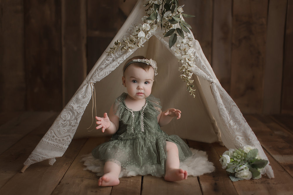 orange-county-baby-photographer-teepee-flowers-girl-green-boho.jpg