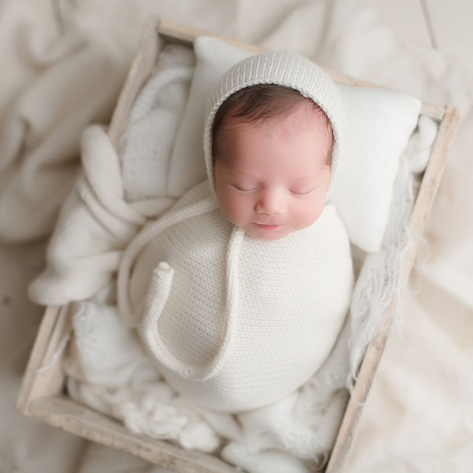 orange-county-newborn-photography-studio-irvine-california-all-white-set-white-wood-blankets-crate-baby-boy.jpg