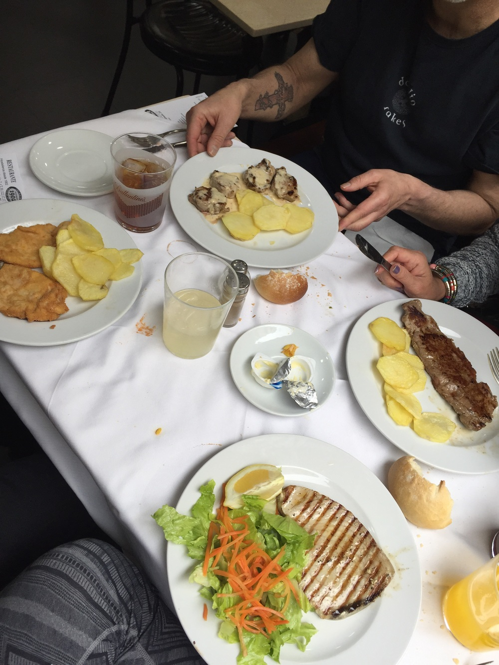 Simple yet delicious food. Starting from the bottom and going clockwise: grilled tuna steak with salad, pan-fried chicken cutlet with potatoes, pan-fried pork cutlets with a pimiento bernaise sauce with potatoes, steak with potatoes.