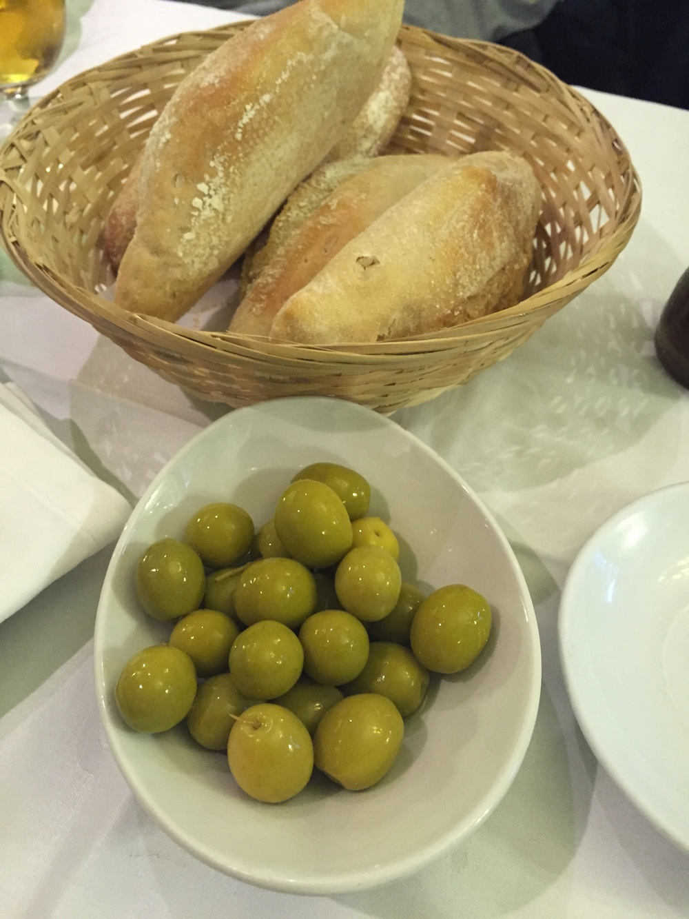 Getting complimentary olives. Oh God bless the olives. I always eat more than half of the olives. I love the olives here because they seem to be soaked in only salt and water and they're not heavily acidic.
